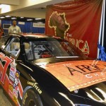 The Africa Channel booth with official NASCAR
